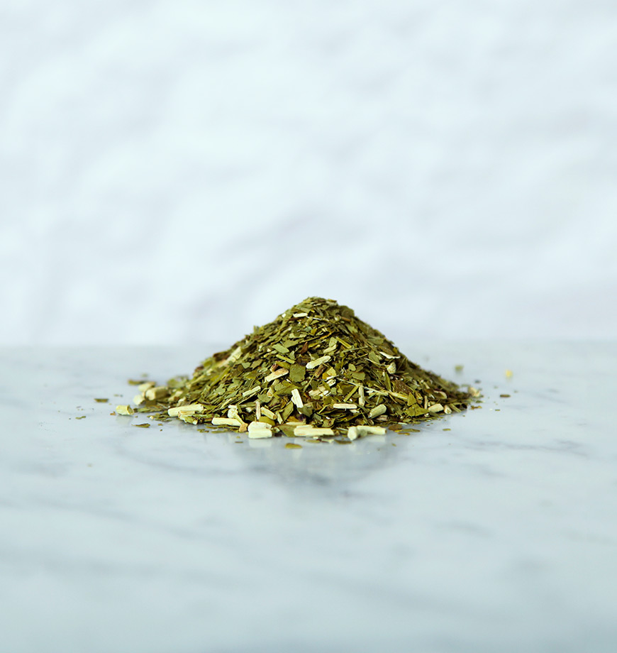 A collection of Yerba Mate Leaves on a marbled surface